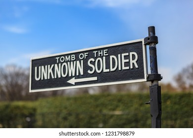 Arlington, VA, USA - April 11, 2013: US Tomb of the Unknown Soldier directional sign at the Arlington National Cemetery.
