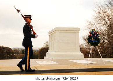 Arlington, VA, USA April 7, 2009 A lone guard marches in front of the Tomb of the Unknowns in Arlington National Cemetery in Virginia.  The Honor Guard keeps a ceremonial vigil for those who fell.