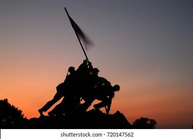 Arlington, VA, USA August 6, 2010 Dawn brightens the sky around the Marine