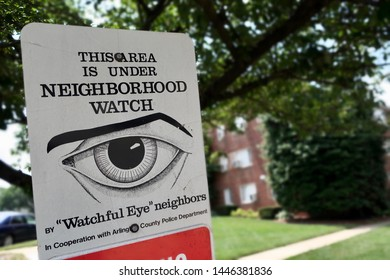 ARLINGTON, VA, USA - JULY 6, 2019: This Area is Under Neighborhood Watch - sign display at entrance to residential area indicates crime watch in cooperation with area police department