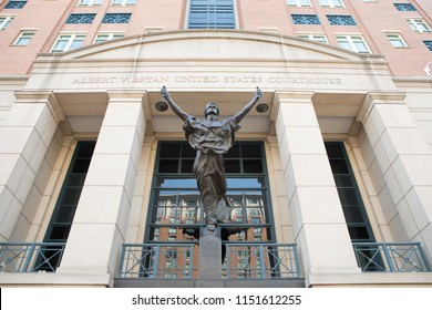 ARLINGTON, VA / USA - JUNE 30, 2018: Lady Justice Statue in front of the Albert V Bryan United States Courthouse in Alexandria, VA.