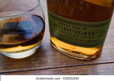 Arlington, VA, USA - November - 18, 2016: Poured glass of Bulleit Rye Small Batch Whisky