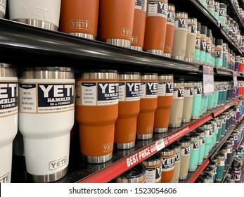 ARLINGTON, VA, USA - OCTOBER 5, 2019:  YETI THERMOS TUMBLER  - brand logo sign at retail store aisle