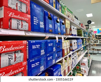 ARLINGTON, VA, USA - SEPTEMBER 15, 2019: BUDWEISER BEER BUD LIGHT brand logo sign - display shelf aisle at TARGET store