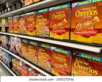 ARLINGTON, VA, USA - SEPTEMBER 15, 2019: HONEY NUT CHEERIOS General Mills product brand logo sign  - display case shelf aisle at TARGET store