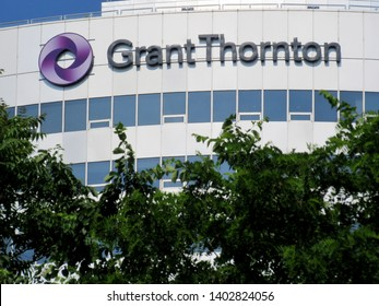 Arlington, Va./USA-May 20, 2019: A sign for Grant Thornton atop 1000 Wilson Blvd., in Rosslyn. The accounting firm has its international tax practice in the tower.