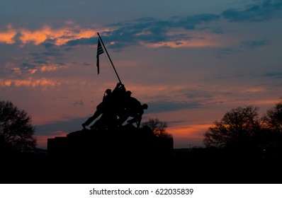 Arlington, Virginia - April 7, 2017: The United States Marine Corps War Memorial in silhouette just after sunset.