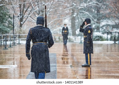 Arlington, Virginia / United States – December 9 2017:  The changing of the guard during a snowstorm at Arlington National Cemetery.