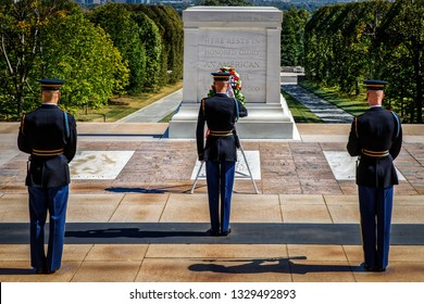 Arlington, Virginia / United States – October 3, 2017: Three unidentified US Army soldiers render a salute at the Tomb of the Unknown Soldier at Arlington National Cemetery.