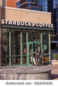 ARLINGTON, VIRGINIA, USA - FEBRUARY 24, 2009: Starbucks coffee shop, exterior, and customers at entrance door.