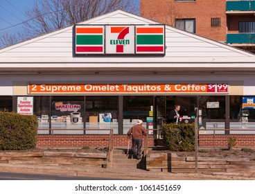 ARLINGTON, VIRGINIA, USA - FEBRUARY 24, 2009: 7-Eleven convenience store and customers near entrance.