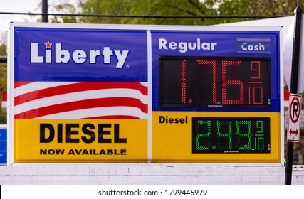 ARLINGTON, VIRGINIA, USA - MAY 11, 2020: Low gas prices sign during Covid-19 Coronavirus.