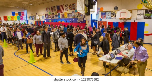 ARLINGTON, VIRGINIA, USA - NOVEMBER 6, 2018: Voters in long queue during midterm voting, at Key School.