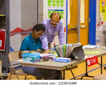 ARLINGTON, VIRGINIA, USA - NOVEMBER 6, 2018: Election officials at work during midterm voting, at Key School.