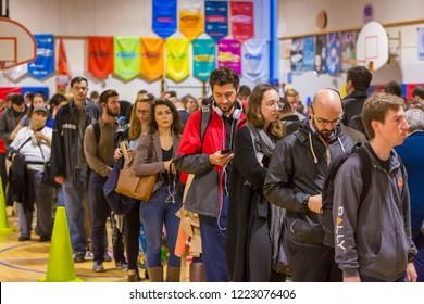 ARLINGTON, VIRGINIA, USA - NOVEMBER 6, 2018: Voters in long queue during midterm voting, at Key School.