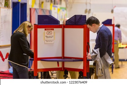 ARLINGTON, VIRGINIA, USA - NOVEMBER 6, 2018: People cast their votes during midterm voting, at Key School.
