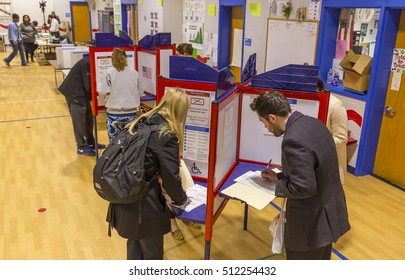 ARLINGTON, VIRGINIA, USA - NOVEMBER 8, 2016: Voters fill our paper ballots, mid-morning on presidential election day.