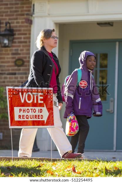 ARLINGTON, VIRGINIA, USA - NOVEMBER 8, 2016: Voters on presidential election day.