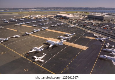 ARLINGTON, VIRGINIA, USA - OCTOBER 29, 1999: Private jets and prop planes parked at Reagan National Airport