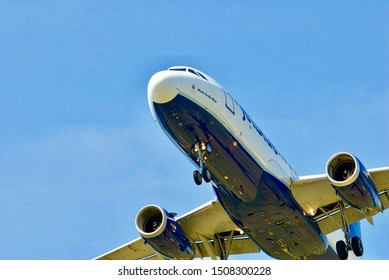 Arlington, Virginia / USA - September 11, 2019: A Jet Blue Airbus A320 passenger airplane prepares to land on its final approach to Ronald Reagan Washington National Airport near Washington, D.C.