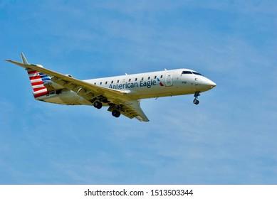Arlington, Virginia / USA - September 11, 2019:  Closeup of an American Eagle regional passenger jet on final approach to Ronald Reagan Washington National Airport near Washington, D.C.