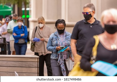 ARLINGTON, VIRGINIA, USA - SEPTEMBER 18, 2020: People line up during first day of early voting, 2020 presidential election.