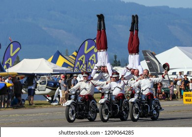 Arlington, WA, USA - July 12, 2014: Since 1938 the Seattle Cossacks Motorcycle Stunt and Drill Team have been entertaining and amazing public audiences on their vintage Harley's with stunts.