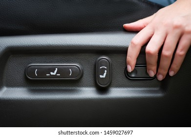 arm adjusting the seat position in the car