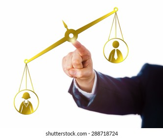 Arm of a businessman reaching out to touch a virtual pair of balances that weigh a female and a male office worker. The weighing scale is leaning towards the female worker. Career and success theme.