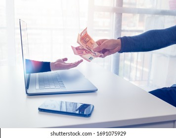 An arm comes out of a laptop to extort money from a person in front