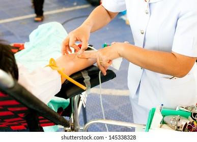arm of a donor donating blood at hemotransfusion station