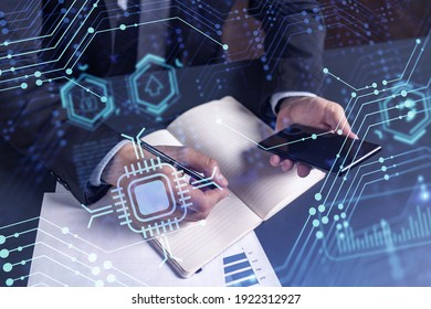 Arm in formal wear writing down some ideas using phone to create innovative software to provide a completely new high-tech service. Close up shot. Hologram tech graphs. Concept of Dev team - Shutterstock ID 1922312927
