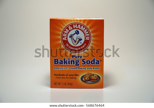 Arm & Hammer pure baking soda brand product shot. Most recognizable US trademark, household deodorizing ingredient - Illustrative Editorial.