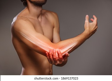Arm pain, the person is holding the painful elbow