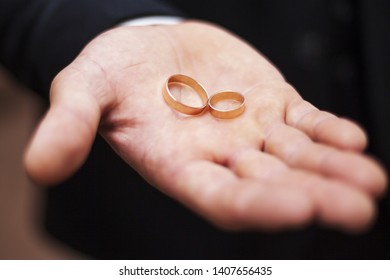 Arm with two wedding rings.
