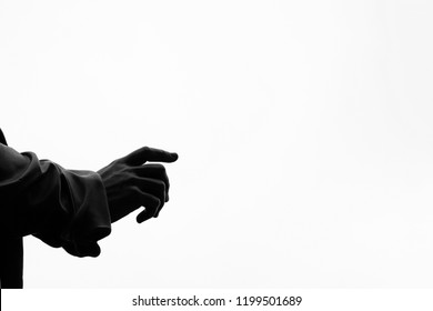 Arm with white background points in one direction