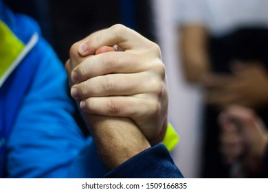 Arm wrestling competitions. Men are measured by force. Hands clasped and fighting among themselves. The game is who is stronger. Guys with strong hands test each other for the power of their hands.