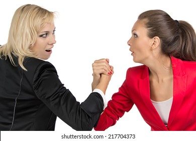 Arm wrestling of two smiling business woman