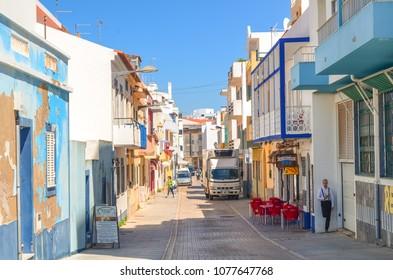 Armacao de Pera, Algarve/Portugal - 7th April 2017: A narrow street with restaurants and cafes in Armacao de Pera