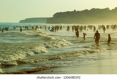 Armacao de Pera, Portugal, 20 July 2017: Bathing people in the evening on the beach Armacao de Pera