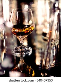 Armagnac in snifter on glass table.
