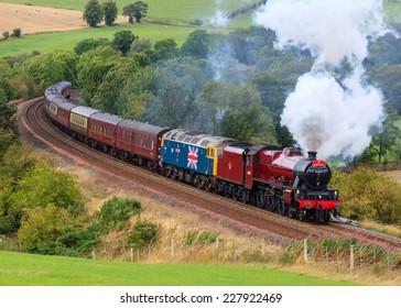 ARMATHWAITE, ENGLAND - AUGUST 17: Preserved steam locomotive Galatea heads the Waverley through Armathwaite on August 17, 2014, on the Settle to Carlisle railway.