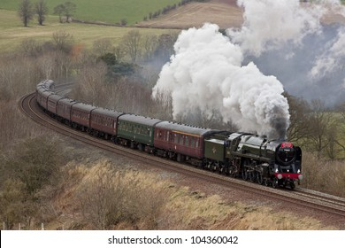 ARMATHWAITE, ENGLAND - FEBRUARY 25: Preserved steam locomotive 70013 Oliver Cromwell heads the Cumbrian Mountain Express through Armathwaite on February 25, 2012, on the Settle to Carlisle railway.