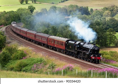 ARMATHWAITE, ENGLAND - JULY 23: Preserved steam locomotive 45305 heads the Cumbrian Mountain Express through Armathwaite on July 23, 2011, on the Settle to Carlisle railway.