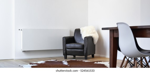 Armchair destroyed by a cat in a white loft