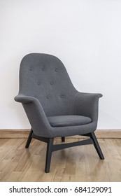 armchair in grey with contemporary design
