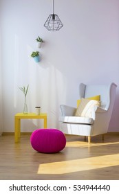 Armchair, pouf and table in a living room