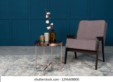 Armchair and side table with vases in blue room