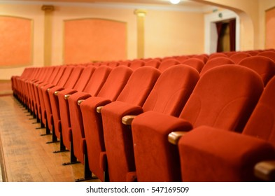 Armchair Theater. Classical theater seats deep red.