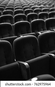 Armchairs of old theater as conceptual background. Black-white photo.